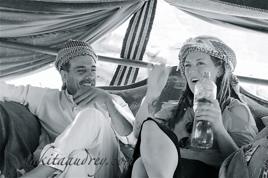 Bedouin guide and Irish tourist sharing a laugh Wadi Rum Jordan
