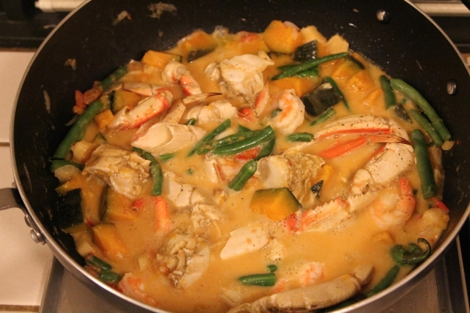 Crab in coconut milk while cooking